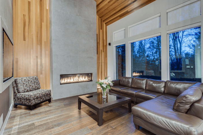 The stone and fireplace surrounded by cedar inlay provided a strong statement feature for the open concept living area.